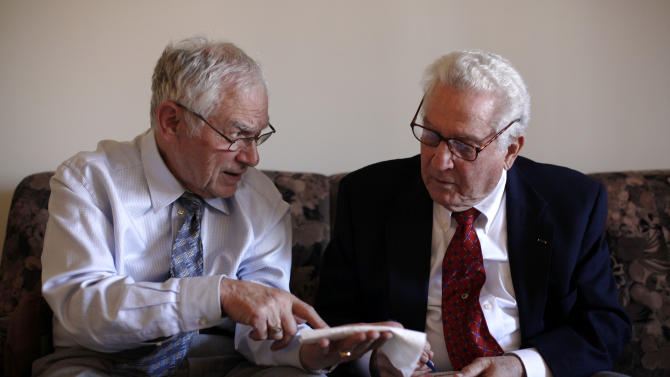 In this Thursday, Feb. 23, 2012 photo, Dachau survivor Ernie Gross, left, and Dachau liberator Don Greenbaum speak amongst themselves during an interview with the Associated Press in Philadelphia. (AP Photo/Matt Rourke)
