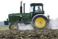 <p>               In this April 2, 2012 photo, Derek Long uses a John Deere tractor to disk and cultivate a field in preparation for planting corn in Loami, Ill. A slowing global economy and the effects of a prolonged U.S. drought caught up to Deere & Co. in its fiscal third quarter, as its net income rose 11 percent but fell well short of Wall Street's expectations. (AP Photo/Seth Perlman)