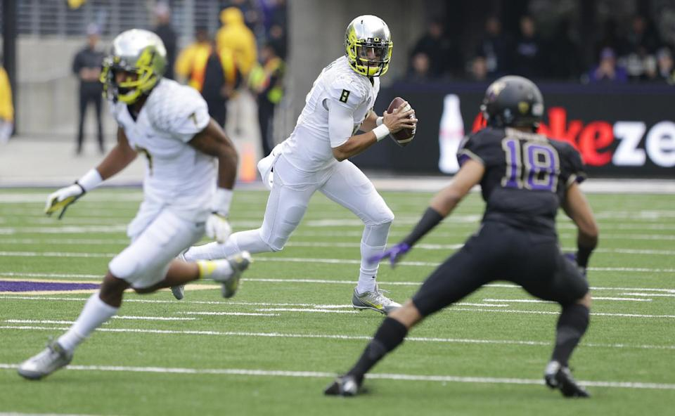 Mariota leads No. 2 Oregon past Huskies 45-24
