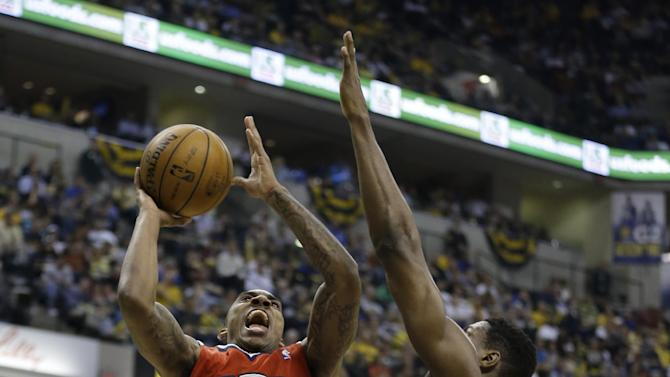 Atlanta Hawks' Jeff Teague (0) shoots against Indiana Pacers' Ian Mahinmi (28) during the first half of Game 5 in the first round of the NBA basketball playoff series on Wednesday, May 1, 2013, in Indianapolis. (AP Photo/Darron Cummings)