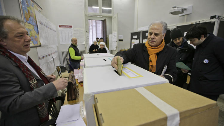 A man casts his ballot in a polling station in downtown Rome, Sunday, Feb. 24, 2013. Italy votes in a watershed parliamentary election Sunday and Monday that could shape the future of one of Europe's biggest economies. (AP Photo/Andrew Medichini)