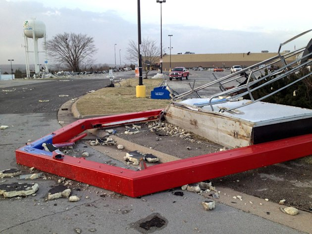 A toppled sign lies in a street  Wednesday, Feb. 29, 2012, in Branson, Mo.  A powerful storm system  lashed the Midwest early Wednesday, roughing up the country music resort city of Branson and laying