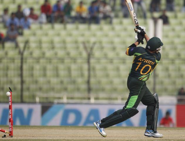 Pakistan's Afridi is bowled out against Afghanistan during their Asia Cup 2014 ODI cricket match in Fatullah