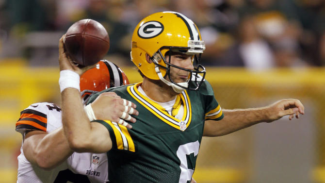 Cleveland Browns' Auston English (94) causes Green Bay Packers quarterback Graham Harrell to intentionally ground the ball from the end zone for a safety during the second half of a preseason NFL football game Thursday, Aug. 16, 2012, in Green Bay, Wis. (AP Photo/Mike Roemer)