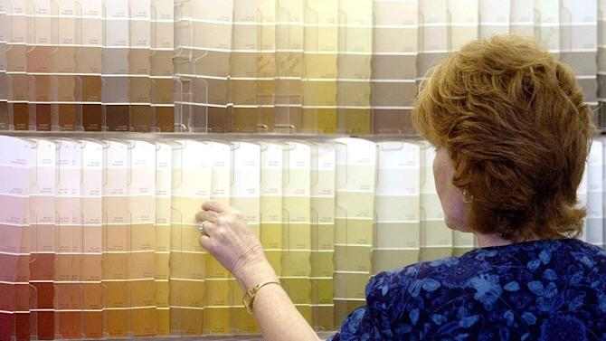 FILE -In this Monday June 28, 2004, file photo, a customer looks over color chips at a Sherwin Williams store in Columbus, Ohio. Sherwin-Williams is buying the privately held Mexican paint company Consorcio Comex in an all-cash deal valued at about $2.34 billion. Consorcio Comex, S.A. de C.V., sells paints and coatings under several brands in the United States and Canada, and it sells architectural and industrial coatings in Mexico. It has company-operated stores and also works with independent paint dealers. The company is based in Mexico City and (AP Photo/Jay LaPrete, File)