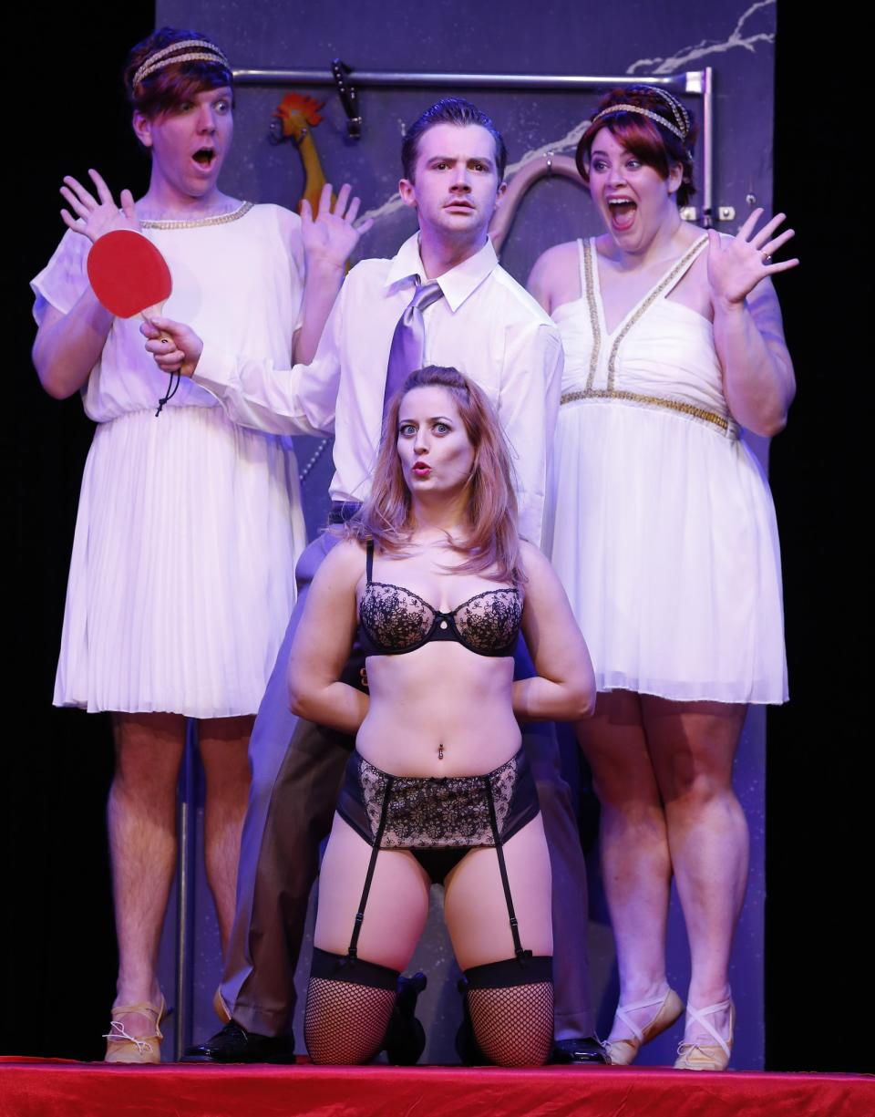 "This theater publicity image released by David Gersten & Associates shows clockwise from top left, Alex Gonzalez, Matthew Brian Bagley, Tina Jensen and Laurie Elizabeth Gardner during a performance of ""Cuff Me: The Fifty Shades of Grey (Unauthorized) Musical Parody,"" in New York. (AP Photo/David Gersten & Associates, Carol Rosegg)"