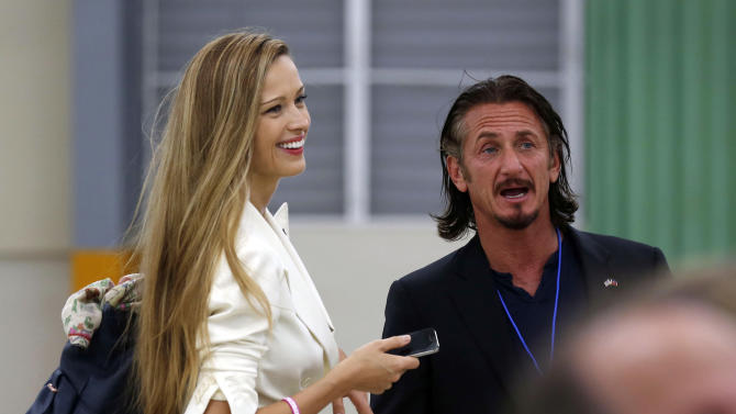 Actor Sean Penn and model Petra Nemcova talk at the grand opening ceremony of the new Caracol Industrial Park in Caracol, Haiti, Monday, Oct. 22, 2012.  Secretary of State Hillary Rodham Clinton, and husband, former President Bill Clinton, arrived in northern Haiti Monday leading a delegation of foreign investors and a crowd of celebrities to showcase the centerpiece of the U.S. effort to help the country recover from the 2010 earthquake.  (AP Photo/Larry Downing, Pool)