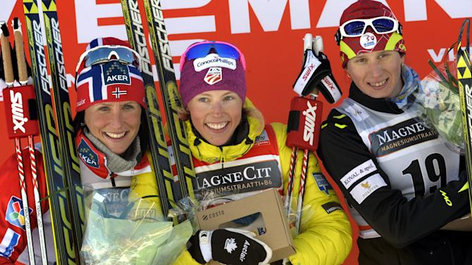U.S. Kikkan Randall, centre, celebrates after winning the ladies World Cup sprint event at the Lahti Ski Games in Lahti, Finland, on Saturday, March 9, 2013. Randall was joined on podium by Norway's second-placed Marit Bjoergen, left, and Slovakia's third-placed Alena Prochazkova, right. (AP Photo / Markku Ulander ) FINLAND OUT - NO SALES