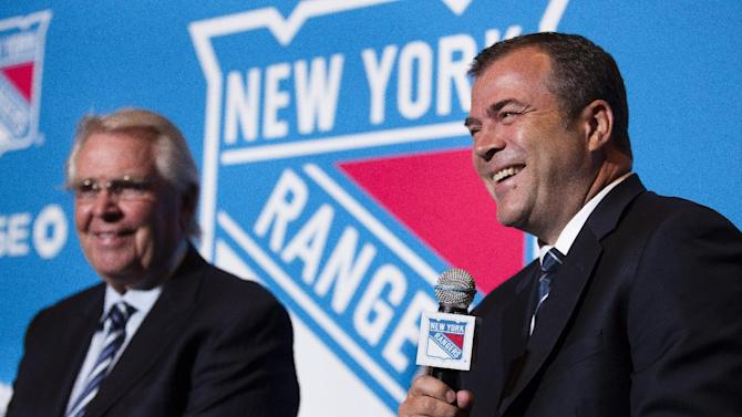 New York Rangers new hockey head coach Alain Vigneault speaks during a news conference alongside the Rangers president and general manager Glen Sather, at Radio City Music Hall, Friday, June 21, 2013, in New York. Vigneault, 52, comes to the Rangers after seven years as coach of the Vancouver Canucks. (AP Photo/John Minchillo)