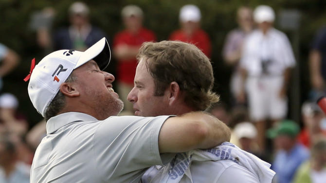 Boo Weekley, left, hugs his caddie, Barry Williams, after winning the Colonial golf tournament on Sunday, May 25, 2013, in Fort Worth, Texas. (AP Photo/LM Otero)