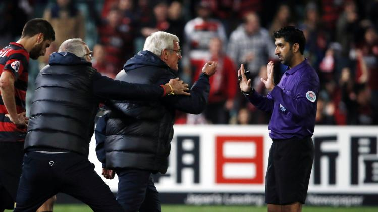 Guangzhou Evergrande's coach Marcello Lippi of Italy invades the pitch to argue with referee Mohammed Mohamed during their AFC Champions League quarter-final soccer match against Western Sydney Wanderers in Sydney