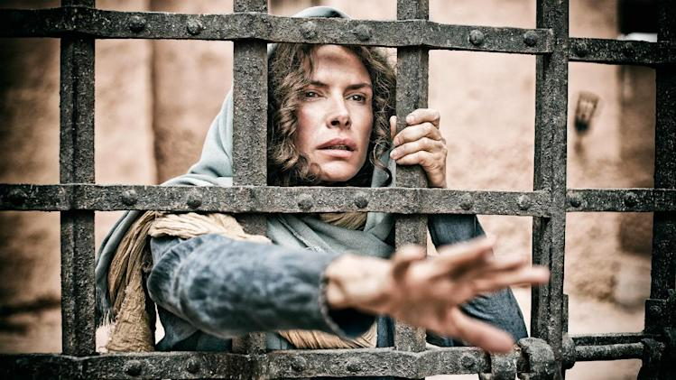 """This publicity image released by History shows Roma Downey as Mother Mary in a scene from """"The Bible,"""" premiering Sunday, March 3 at 8 p.m. EST on History. (AP Photo/History, Casey Crawford)"""