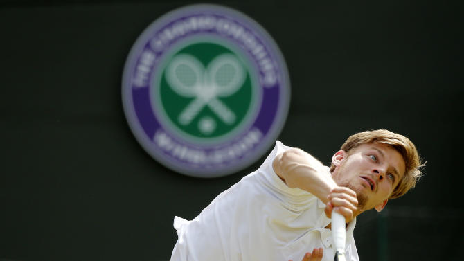 David Goffin of Belgium serves during his match against Stan Wawrinka of Switzerland at the Wimbledon Tennis Championships in London