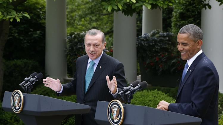 President Barack Obama smiles as Turkish Prime Minister Recep Tayyip Erdogan speaks during their joint news conference in the Rose Garden of the White House in Washington, Thursday, May 16, 2013. (AP Photo/Charles Dharapak)