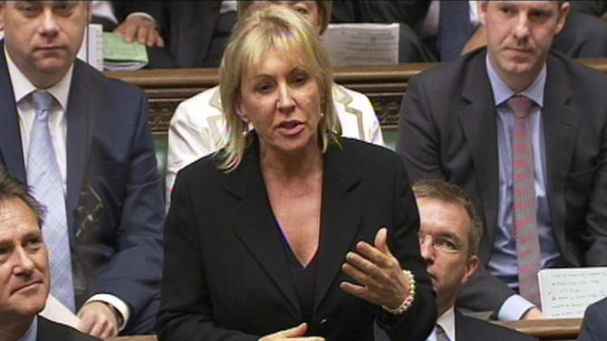 """FILE - In this photo made from video on Sept. 5, 2012,  Conservative MP Nadine Dorries talks during Parliament, in London. A British lawmaker is swapping the political jungle for the Australian rainforest and becoming a contestant on a reality TV show. A British lawmaker is swapping the political jungle for the Australian rainforest and becoming a contestant on a reality TV show. Dorries was slammed Tuesday, Nov. 6, 2012, for taking up to a month off from her parliamentary duties. Former Conservative legislator Harry Greenway called the decision """"outrageous."""" (AP Photo/PA)  UNITED KINGDOM OUT  NO SALES  NO ARCHIVE As well as risking the anger of those she represents for taking extended leave from her day job, she will also face questions from senior MPs, The Sun said. See PA story SHOWBIZ Dorries. Photo credit should read: PA Wire"""