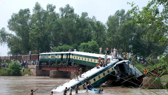 Pakistan Army soldiers and rescue workers conduct search operations after a train fell in a canal near Gujranwala