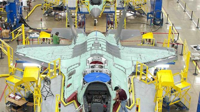 File handout photo of workers on the moving line and forward fuselage assembly areas for the F-35 JSF at Lockheed Martin Corp's factory located in Fort Worth, Texas