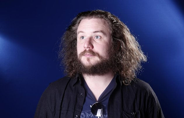 FILE - This March 15, 2012 file photo shows musician Jim James in New York. James has picked &quot;Sleep No More&quot; as one of the stops on his tour promoting &quot;Regions of Light and Sound of God,&quot; his first full-length solo album. Now approaching its second year, &quot;Sleep No More&quot; has found itself evolving into a music destination in addition to a theatrical one. (AP Photo/Carlo Allegri, file)
