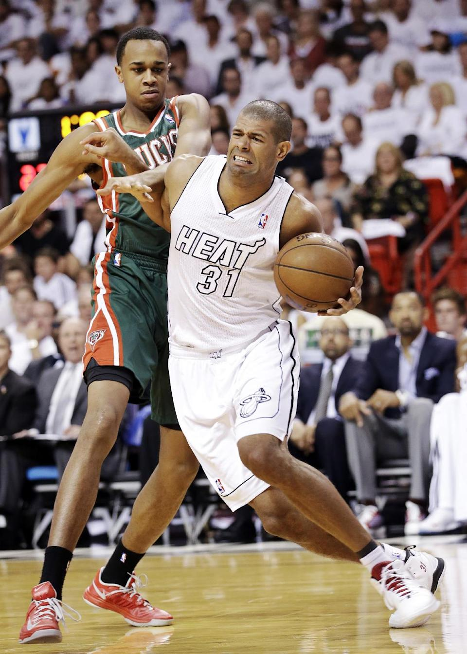 Milwaukee Bucks forward John Henson, left, fouls Miami Heat forward Shane Battier (31) as he goes up for a shot during the first half of Game 2 in their first-round NBA basketball playoff series, Tuesday, April 23, 2013 in Miami. (AP Photo/Wilfredo Lee)
