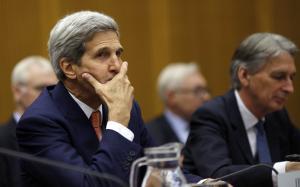 U.S. Secretary of State John Kerry gestures as he sits…