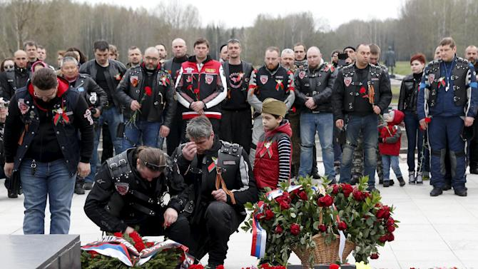 "Members of the Night Wolves motorcycle club and other local Belarusian bikers visit the war memorial ""Khatyn"" during a bike ride commemorating the 70th anniversary of the victory over Nazi Germany in World War Two, northeast of Minsk"