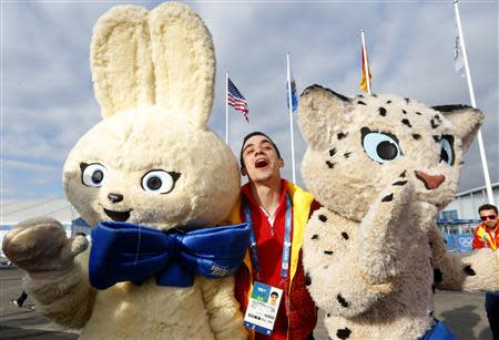 Spanish figure skater Javier Fernandez poses with Olympic mascots during the welcoming ceremony for the Spanish Olympic team in the Athletes Village at the Olympic Park ahead of the 2014 Winter Olympic Games in Sochi
