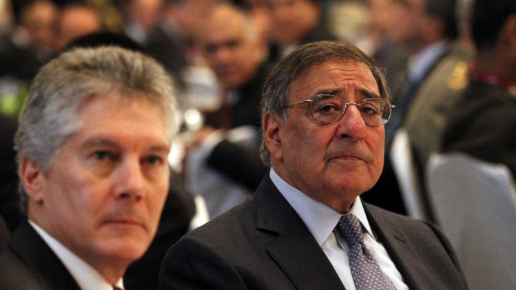 U.S. Defense Secretary Leon Panetta, right, and Australia's Defense Minister Stephen Smith, left, attend the opening session of the IISS Shangri-la Security Summit in Singapore on Friday June 1, 2012. (AP Photo/Wong Maye-E)