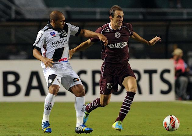 SAO PAULO, Dec. 5, 2013 (Xinhua/IANS) -- Leandro Daniel (R) of Argentina's Lanus vies for the ball during the first leg final match of the Copa Sudamericana against Brazil's Ponte Preta at the