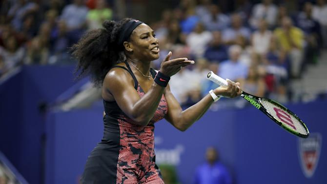 Williams of the U.S. reacts after losing a point against Mattek-Sands of the U.S. during their match at the U.S. Open Championships tennis tournament in New York