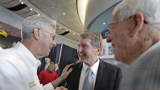 Bill Elliott, center, is congratulated by Leonard Wood, left, and Glen Wood after being named as one of five inductees into the NASCAR Hall of Fame class of 2015, in Charlotte, N.C., Wednesday, May 21, 2014