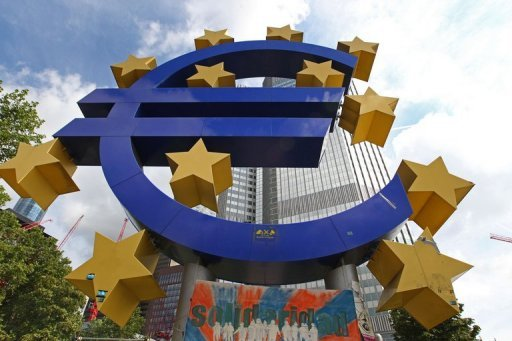 <p>A giant logo of the Euro currency stands in front of the European Central Bank (ECB) in the banking district of Frankfurt in July 2012. Spain's short-term borrowing costs tumbled Tuesday as it raised 4.51 billion euros ($5.6 billion), buoyed by the possibility of European Central Bank invervention.</p>