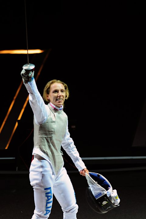 Italy's Valentina Vezzali celebrates defeating US Lee Kiefer during the Women's Foil semi-finals at the 2011 World Fencing Championships in Catania on October 11, 2011. AFP PHOTO / GIUSEPPE CACACE (Ph