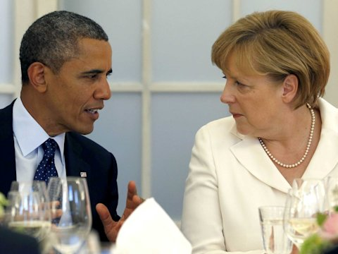 U.S. President Barack Obama and German Chancellor Angela Merkel (R) chat during at the Chralottenburg Castle in Berlin June 19, 2013.