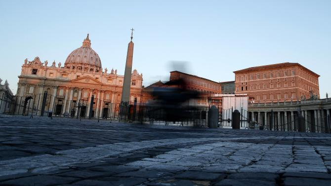A bike goes past Saint Peter's Basilica at the Vatican