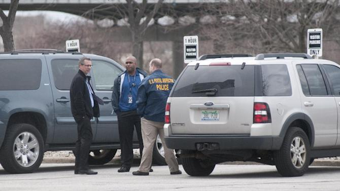 Federal law enforcement, including a U.S. Postal Inspector, were on scene to investigate a suspicious letter that arrived at U.S. Sen. Carl Levin's Saginaw office in the Wickes Building, 515 N. Washington in Saginaw on Weds., April 17, 2013.  (AP Photo/The Saginaw News,Jeff Schrier) ALL LOCAL TV OUT; LOCAL TV INTERNET OUT
