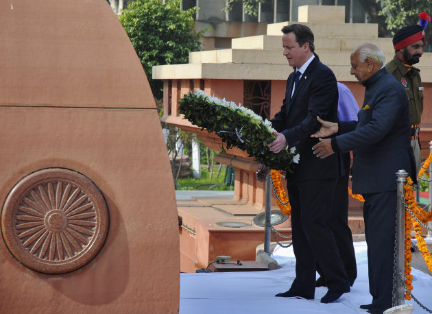David Cameron places a wreath at the Jallianwala Bagh memorial in Amritsar, the scene of the massacre of unarmed Indians in 1919 (Reuters)