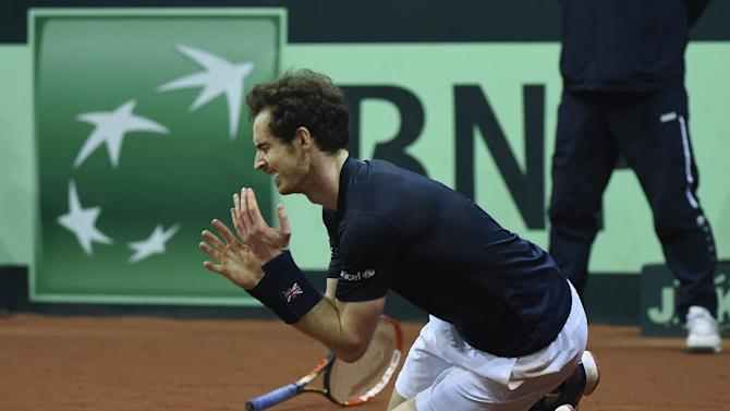 Andy Murray reacts after winning his tennis match against Belgium's David Goffin to win the Davis Cup final for Britain on November 29, 2015
