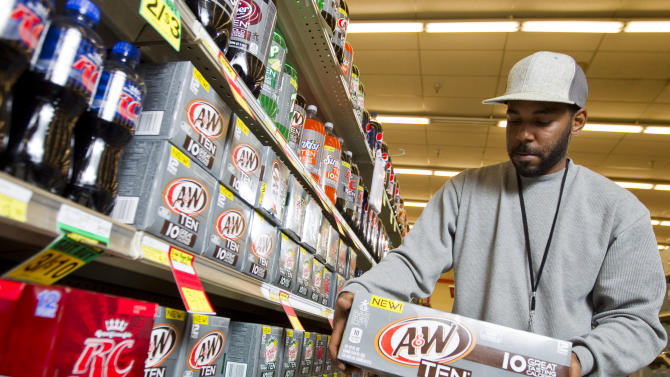 Chris Sneed is seen purchasing A&W TEN at Minyard's Food Store, on Thursday, February, 7, 2013 in Dallas, Texas. Consumers are counting calories more than ever, and beverage companies are responding with new low-calorie options.  In January, Dr Pepper Snapple Group began rolling out ten-calorie versions of five of its most popular soft drink brands including Sunkist TEN Soda, Canada Dry TEN, RC TEN and 7-UP TEN. (Brandon Wade / AP Images for Dr Pepper Snapple Group)