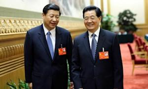 Chinese President Hu Jintao (right) and his successor, Vice President Xi Jinping, walk together after the first meeting of the 18th National Congress of the Communist Party on Nov. 8.