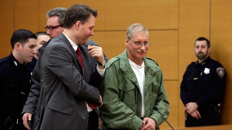 David Ranta, right, stands with his attorney Pierre Sussman, in state Supreme Court in Brooklyn, New York,  Thursday, March 21, 2013. Ranta, 58, who spent more than two decades behind bars was freed by a New York City judge on Thursday after a reinvestigation of his case cast serious doubt on evidence used to convict him in the Feb. 8, 1990 shooting of Rabbi Chaskel Werzberger. (AP Photo/Richard Drew, Pool)