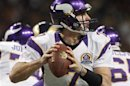 Minnesota Vikings quarterback Christian Ponder looks for a pass during the first half of their NFL football game against the St. Louis Rams in St. Louis