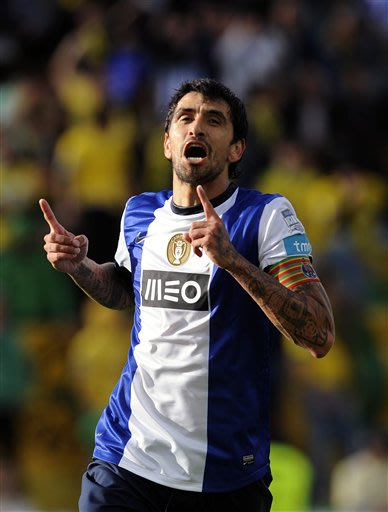 FC Porto's Lucho Gonzalez, from Argentina, celebrates after scoring the opening goal against Pacos Ferreira in the last match of the Portuguese League soccer season at Mata Real stadium in Pacos de Fe