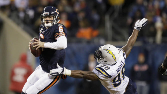 Chicago Bears quarterback Jay Cutler (6) looks to pass while under pressure from San Diego Chargers linebacker Antwan Barnes (98) in the first half of an NFL football game in Chicago, Sunday, Nov. 20, 2011. (AP Photo/Nam Y. Huh)