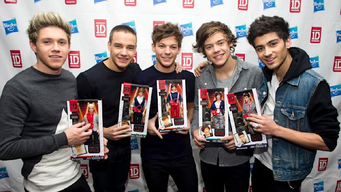 IMAGE DISTRIBUTED FOR HASBRO - Members of worldwide musical sensation One Direction, from left, Niall Horan, Liam Payne, Louis Tomlinson, Harry Styles and Zayn Malik pose with their Hasbro dolls at a press event on Monday, Nov. 26, 2012 in New York. (Photo by Charles Sykes/Invision for Hasbro/AP Images)