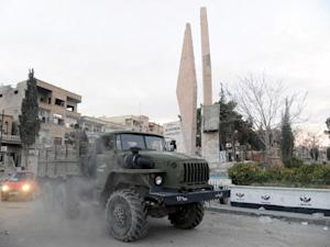 Syrian pro-government forces drive inside a military vehicle after capturing the town of Nabak, north of Damascus, near the border with Lebanon in the Qalamoun region, on December 9, 2013