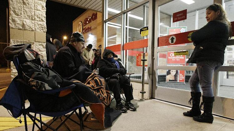 Shoppers wait for the opening at a Kmart in Chicago on Friday, Nov. 25, 2011. Black Friday began in earnest as stores opened their doors at midnight. Thousands of shoppers lined up at Macy's, Best Buy and other stores nationwide to buy everything from toys to tablets on Black Friday despite the economic downturn and some planned protests of the shopping holiday.(AP Photo/Nam Y. Huh)