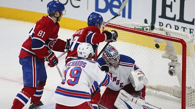 New York Rangers goalie Martin Biron (R) is scored on by Montreal Canadiens Alex Galchenyuk (27), as Canadiens Lars Eller (81) and Rangers Brad Richards (19) look on, during second period NHL hockey action in Montreal (Reuters)