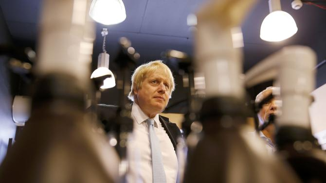 London's Mayor Boris Johnson visits a business whilst campaigning for the local Conservative candidate in Finchley, north London