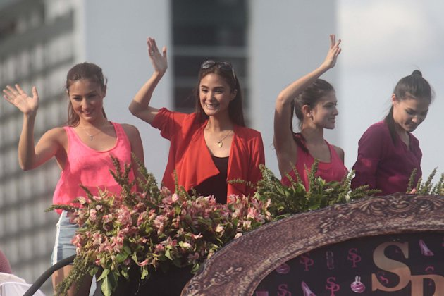 "The cast of ""Sosy Problems"" (L-R) Solenn Heusaff, Heart Evangelista, Bianca King and Rhian Ramos, during the 38th Metro Manila Film Festival (MMFF) Parade of the Stars. (George Calvelo/NPPA Images)"