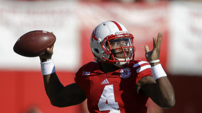 Nebraska quarterback Tommy Armstrong Jr. (4) throws against Rutgers in the first half of an NCAA college football game in Lincoln, Neb., Saturday, Oct. 25, 2014